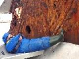 Old Rusty, Sunken Boat Wakes Up Sleeping Man