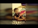 One-year-old Baby Putting Real Gun In Her Mouth
