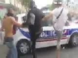 Protesters Vs. Police-Cars In Paris