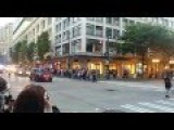 People Watch Chinese President Convoy Going Through US Street