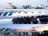Passengers Get Out And Push Frozen Plane In Siberia