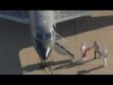 Plainclothes Man At Ebola Scene Handling CONTAMINATED Bags - Amber Vinson Transported To Atlanta