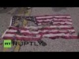 People Destroy US Flag To Remember Black Teen Killed By White Officer