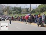 People Have To Wait In Mile Long Line To Buy Daily Necessities In Venezuela