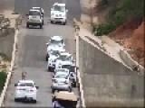 Park Traffic Comes To A Halt As Stray Lion Crosses Bridge