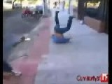 Police Officer Tries Flying Jump Kick But He Fails