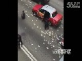 People Rush To Pick Up Money After Boxes Of Cash Fall Off Transport Truck