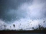 Rain Drops On A Window In Slow Motion
