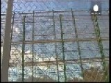 Razor Wire And Chain Mail On Fence To Deter Crossing Into Melilla
