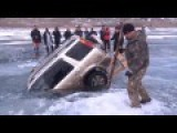 Russian Dragging A Sunken SUV Out Of A Frozen Lake