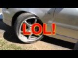 Ricer Does A Burnout And Wrecks Suspension On Curb