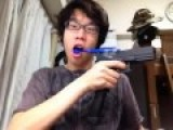Retarded Japanese Kid Uses Gun To Brush Teeth
