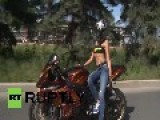 Russia: Sexy Motorbike Stunt Rider Stuns St. Petersburg