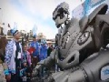Robot Scares And Entertains Children. Russia