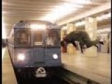 Russian Stunt Guy Jumps And Flips Over In Front Of Subway Train