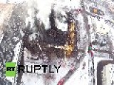 Russia: DRONE Captures Fire-fighters Battling Moscow Library Blaze Aftermath