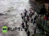 Russia: Watch People Fight Huge Waves To Get Amber Stones