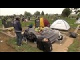 Refugees Desecrate Serbian Cemetery...Camp Out On Graves