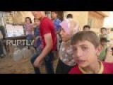 Syria: Civilians Fleeing Aleppo Receive Aid At Makeshift Camp