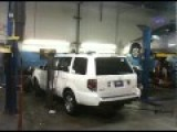 SUV Falls Off Hoist Onto Other Car - FAIL!