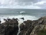 Surfer Gets Caught On Rocks
