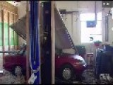 Semi Smashes Into Auto Shop