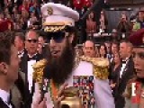 Sacha Baron Cohen Empties Urn Of Kim Jong Il Ashes On Ryan Seacrest