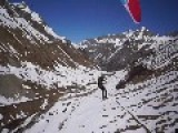 Snow Sports Enthusiasts Try Some Summer Paragliding