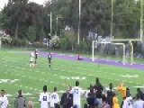 Soccer Player Scores Goal From A Distance