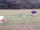 Son Kicks Ball At Dad