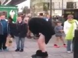 Street Performer Gets Pants Pulled Down Lol