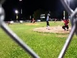 Softball Player Decks Catcher For Home Run