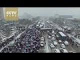 Snow Creates Traffic Havoc In China