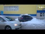 Snow Sliding Off The Roof Of Building In Russia Crushes Car Roof