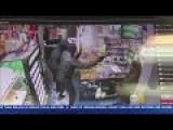 Store Owner Shoots At Armed Robbers