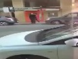 Stealing A Woman's Purse In Public Street
