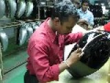 Skilled Craftsman Hand Painting Pinstripes At Royal Enfield Motorcycle Factory In India