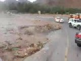 SUV Caught In A Flash Flood But Manages To Escape