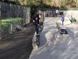 Teens Do Bike Tricks At Skate Park