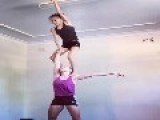 Two Girls Stand Tall On Top Of Each Other