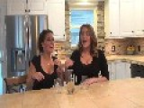 Two Women Down A Bottle Of Helium-Infused Wine