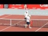 Tennis Player Needs Chair To Hug 6'11' Opponent