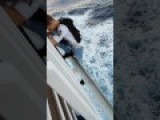 Teen Hangs Off Cruise Ship While Moving