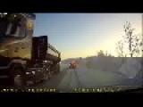 Trailer Topples Over On Snowy Embankment