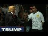 Trumps Rally In OKC, Stares At A Man Wearing A KKK Endorses Trump T-shirt