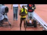 Usain Bolt Floored By Cameraman On Segway As He Celebrates 200m Gold