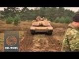 U.S. Sends 'Ironhorse' Tanks To NATO's Nervous Baltic Front Line