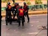 Venezuelan National Guard Straddles, Then Beats Protester With Her Helmet