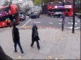 Woman Roller-blades In The Middle Of A Busy London Road