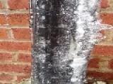Waterfall Flows Inside Frozen Pipe As Ice Melts